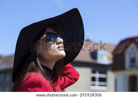 Close-up portrait of a brunette in sunglasses - stock photo