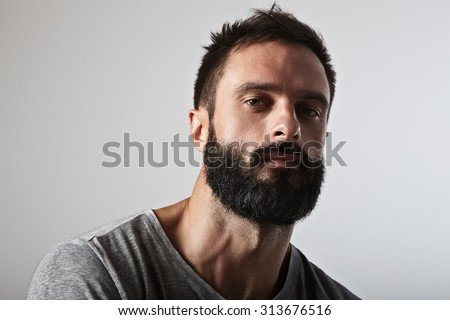 Close-up portrait of a brutal bearded man - stock photo