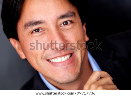 Close up portrait of a business man smiling - stock photo