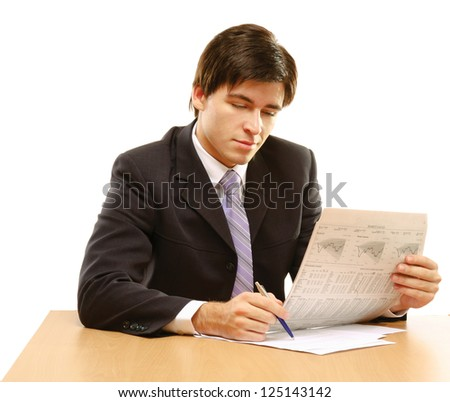 Close-up portrait of a businessman reading newspaper isolated on white background