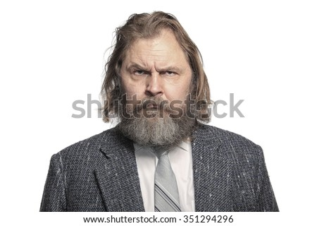 close-up portrait of a charismatic man with a beard and mustache in suit Studio - stock photo