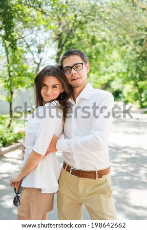 Close-up portrait of a charming couple smiling at the viewer  - stock photo
