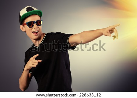 Close-up portrait of a cool young man expressing different emotions. Studio shot. - stock photo