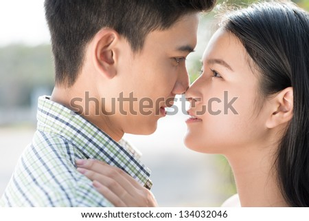 Close-up portrait of a couple looking at each other - stock photo