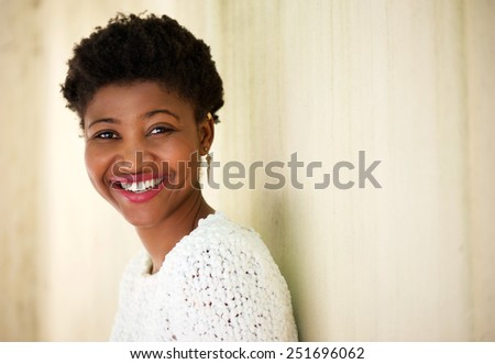 Close up portrait of a cute african american woman laughing - stock photo
