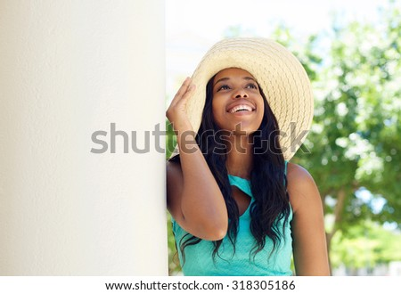 Close up portrait of a cute african american woman smiling with sun hat - stock photo