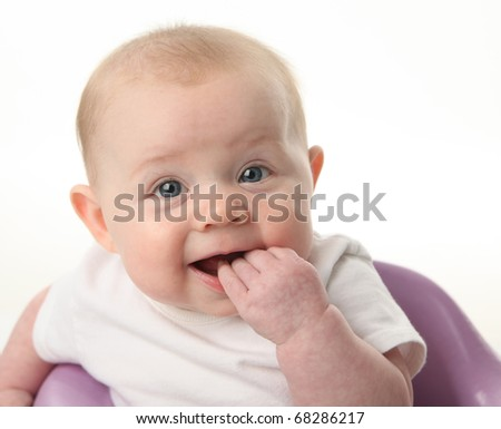 Close up portrait of a cute baby chewing on fingers, isolated on white - stock photo