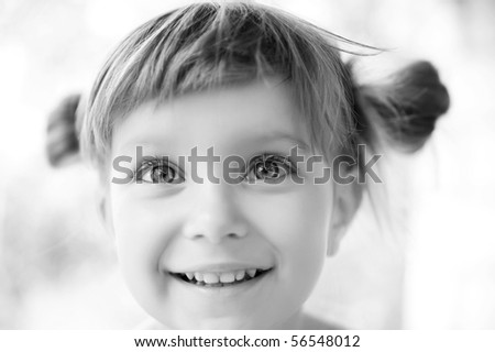 Close-up portrait of a cute liitle girl  black-and-white - stock photo