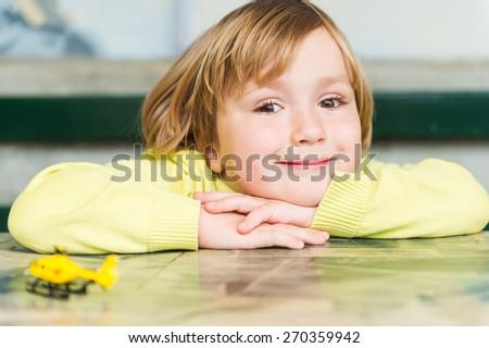 Close up portrait of a cute little boy - stock photo