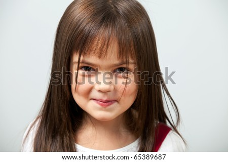 Close up portrait of a cute little girl indoors - stock photo