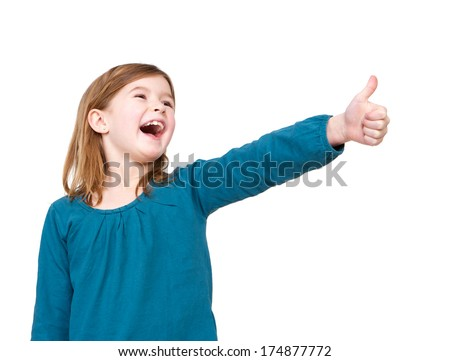 Close up portrait of a cute young girl laughing with thumbs up on isolated white background - stock photo