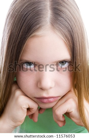 Close-up portrait of a depressed young girl - stock photo