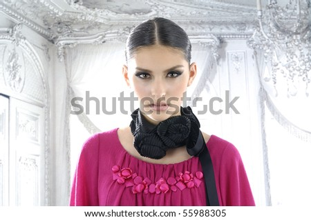Close-up portrait of a fresh and young fashion model - stock photo