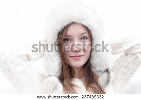Close up portrait of a girl in a cap with earflaps - stock photo