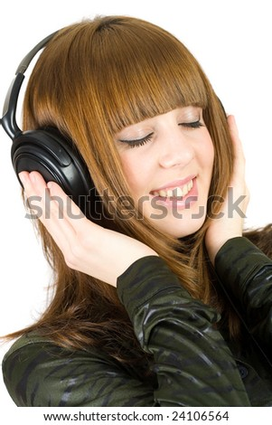 Close-up portrait of a girl listening music at headphones
