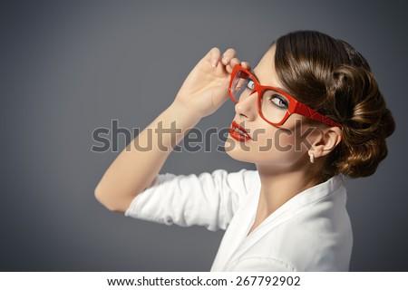 Close-up portrait of a gorgeous young woman wearing glasses. Beauty, fashion. Make-up. Optics, eyewear.  - stock photo