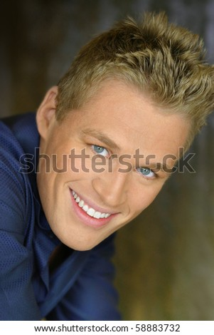 Close up portrait of a great looking young man smiling - stock photo