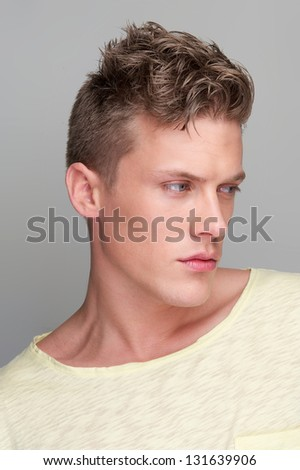 Close up portrait of a handsome man looking away - stock photo