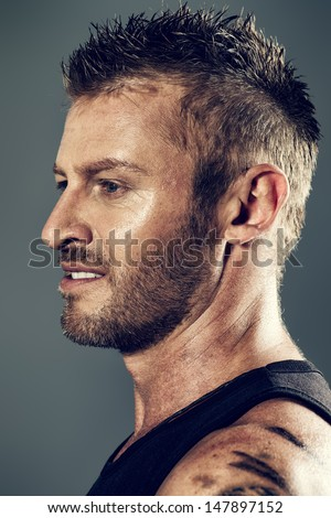 Close-up portrait of a handsome mature man. Profile. - stock photo