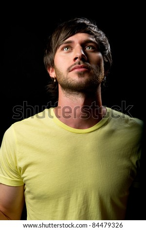 Close-up portrait of a handsome thoughtful young man - stock photo