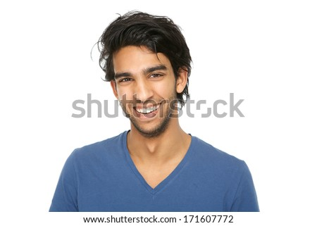 Close up portrait of a handsome young indian man smiling on isolated white background - stock photo