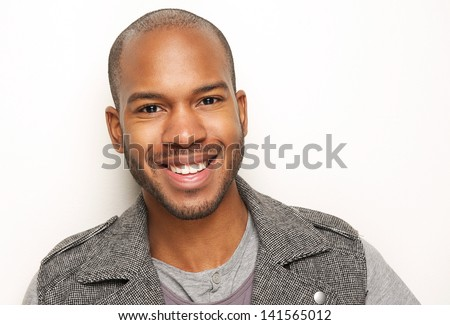 Close up portrait of a handsome young man smiling - stock photo