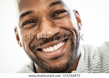Close up portrait of a happy black man in his 20s isolated on a white background - stock photo