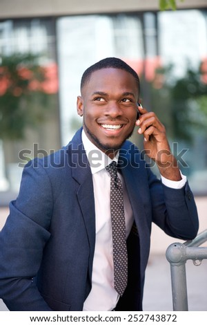 Close up portrait of a happy confident businessman calling by cell phone - stock photo