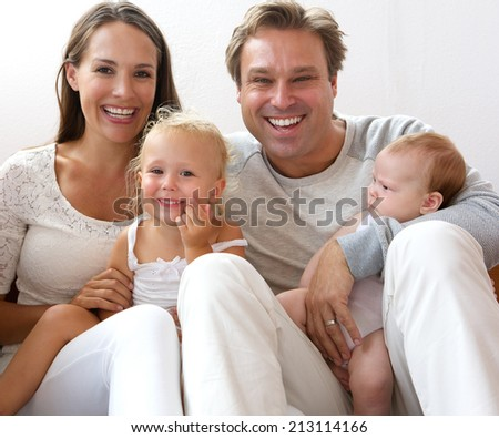 Close up portrait of a happy family smiling at home with children - stock photo