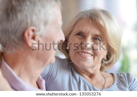 close-up portrait of a happy senior couple at home - stock photo