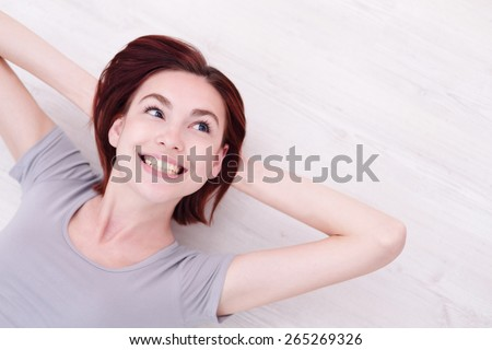 Close up portrait of a Happy young beautiful woman relax lying and look to empty area in the image, great for your design, caucasian beauty - stock photo