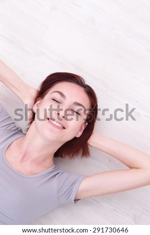 Close up portrait of a Happy young beautiful woman relax lying, caucasian beauty - stock photo