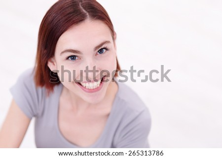 Close up portrait of a Happy young beautiful woman relaxing and sitting, caucasian beauty - stock photo