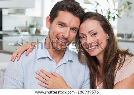 Close-up portrait of a happy young couple at home