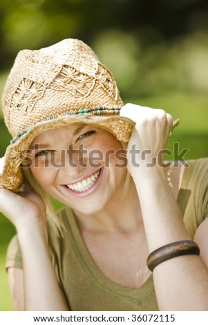 Close-up portrait of a happy young pretty woman smiling