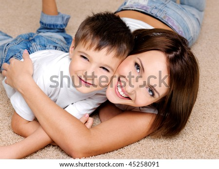 Close-up portrait of a joyful  laughing  mother and her  little boy - stock photo