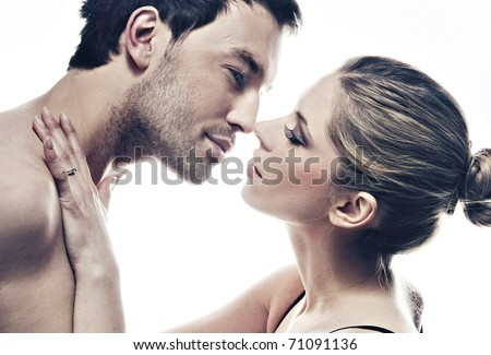 Close up portrait of a kissing couple - stock photo