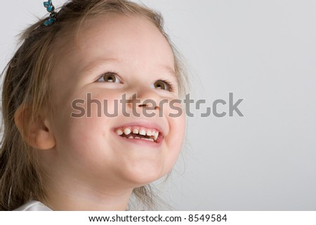 close-up portrait of a laughing girl