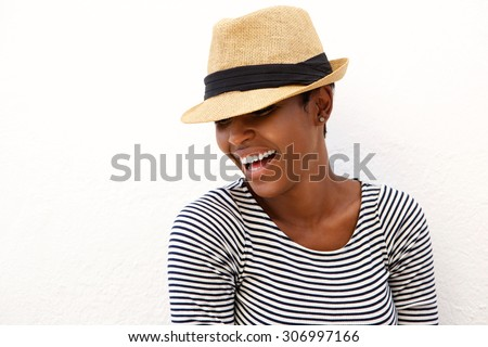 Close up portrait of a laughing woman with hat  - stock photo