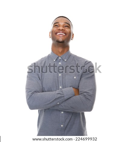 Close up portrait of a laughing young black man with arms crossed on isolated white background - stock photo