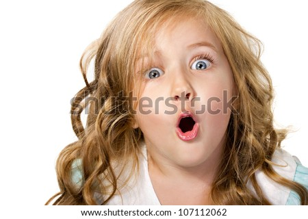 close-up portrait of a little amazing  girl with blue eyes and opening mouth isolated on white - stock photo
