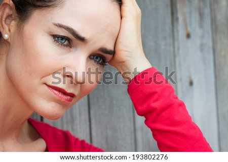 Close-up portrait of a  lonely depressed and sad woman. - stock photo