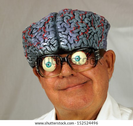 Close up portrait of a mad scientist, whose brain is coming out the top of his head - stock photo