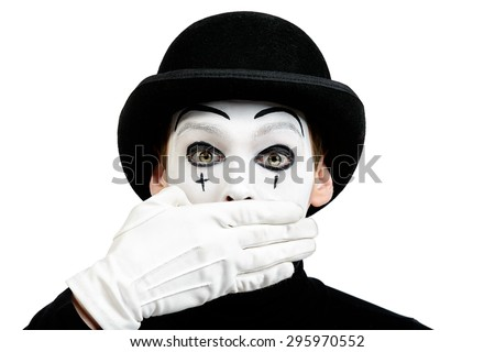 Close-up portrait of a male mime artist showing secret, silence. Isolated over white. - stock photo