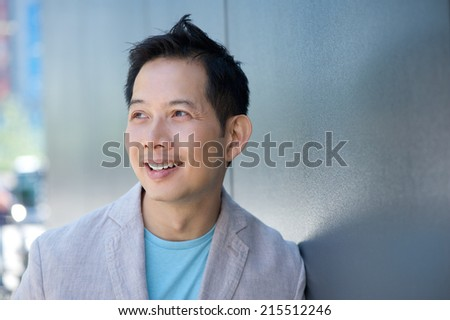 Close up portrait of a middle aged man smiling outdoors  - stock photo