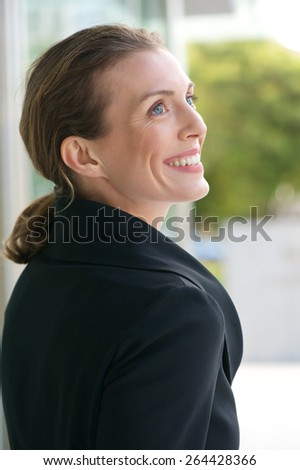 Close up portrait of a modern business woman smiling outside - stock photo