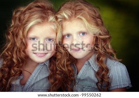 close up portrait of a nice sisters - stock photo