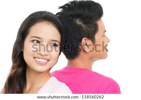 Close-up portrait of a peaceful couple sitting back to back - stock photo