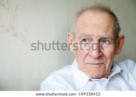 close-up portrait of a pensive senior man, he is looking somewhere - stock photo