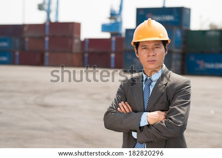 Close-up portrait of a port engineer posing at camera  - stock photo